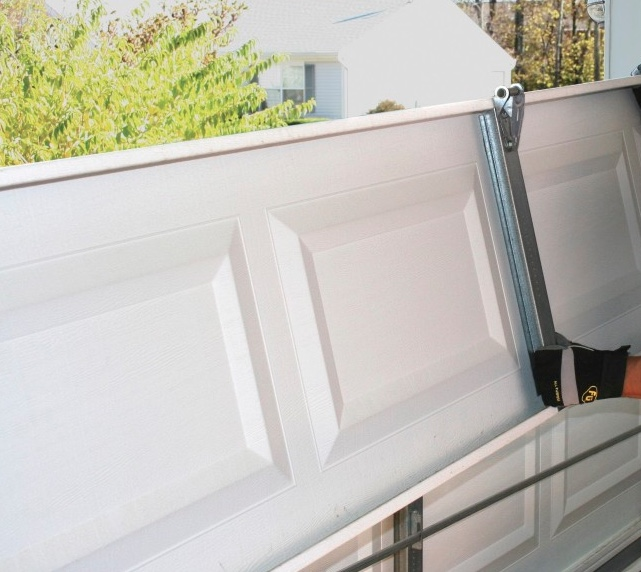 Garage door section repair